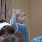 Cute Little Girl Conducts Choir
